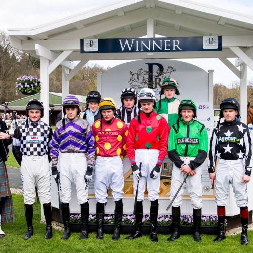 Jockey silks pose in Winners Enclosure