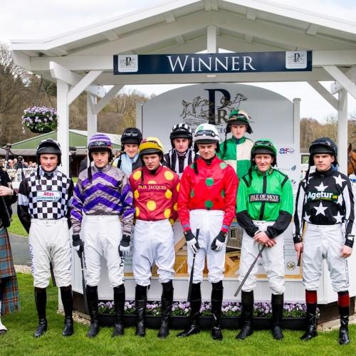 Jockey silks pose in Winners Enclosure